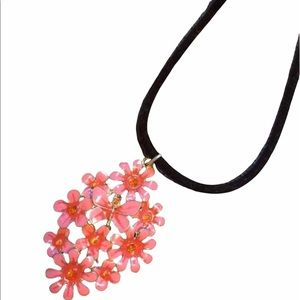 Pink large floral pendant on black cord NEW